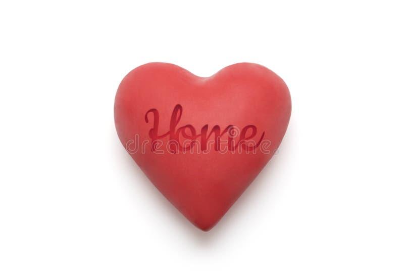 Rood hart met gestempeld huiswoord over witte achtergrond royalty-vrije stock afbeelding