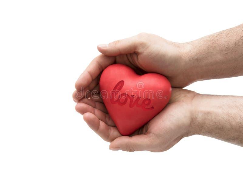 Rood hart met gestempeld liefdewoord in mensen` s handen royalty-vrije stock afbeeldingen