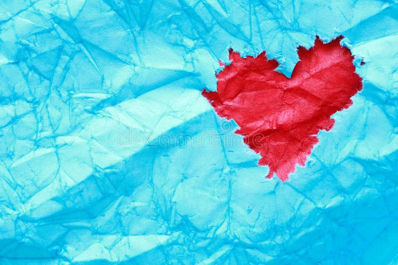 Rood hart op blauw royalty-vrije stock afbeelding