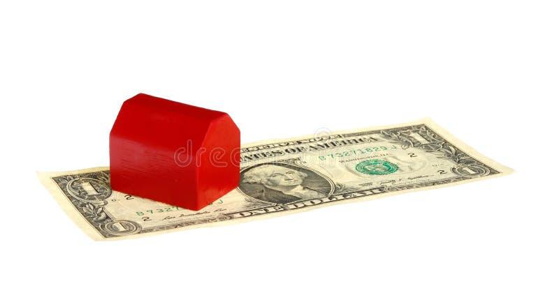 Rood huis op bankbiljet royalty-vrije stock afbeelding