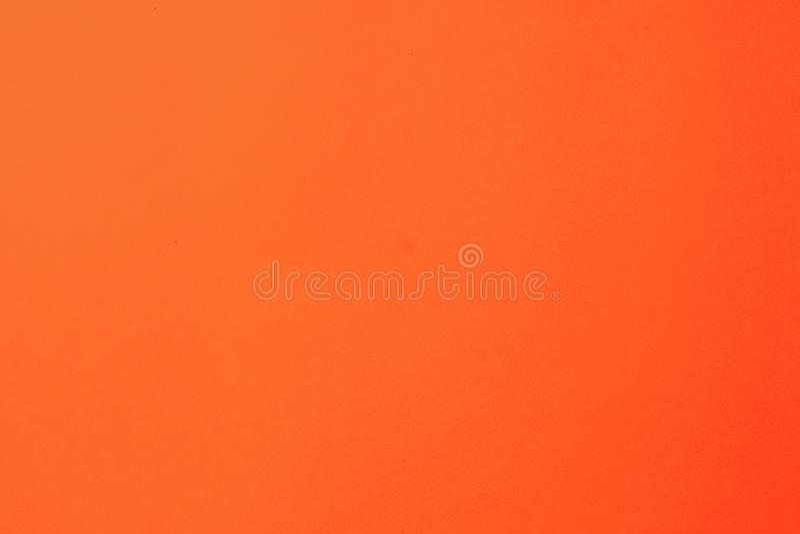 Rood kleurenpapier Lege oranje papieren achtergronden Reinig de structuur van rood papier met een eenvoudig oppervlak Foto met ho stock fotografie