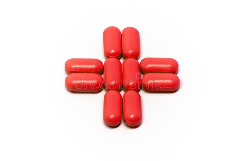 Rood kruis van pillen stock afbeelding