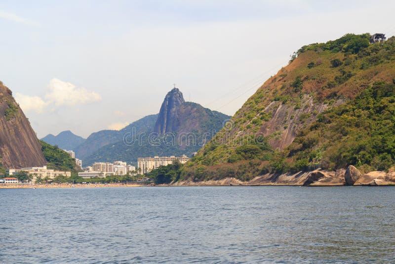 Rood strand Christus de Verlosser Morro DA Urca, Rio de Janeiro stock foto's