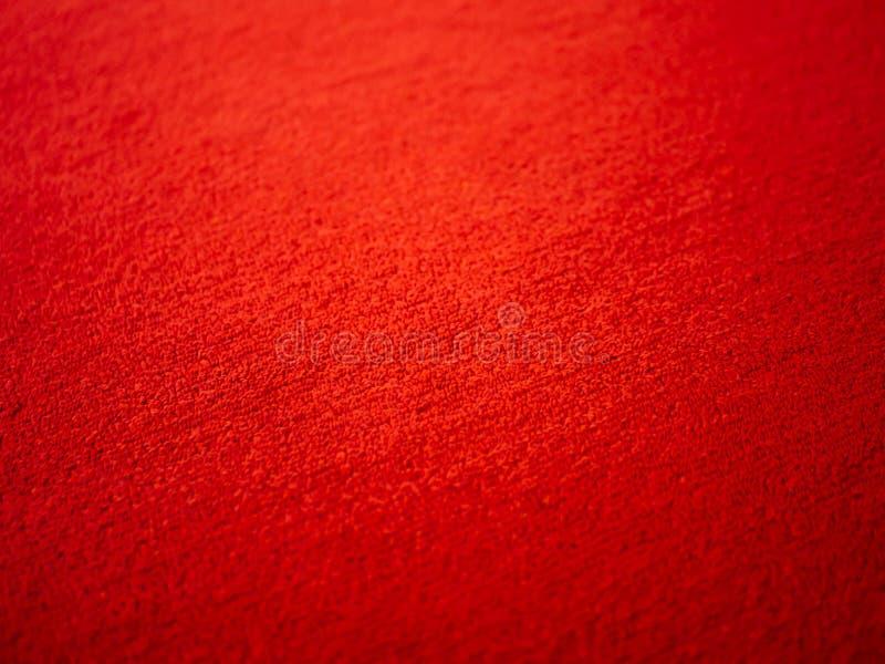 Rood tapijt, elegantie rode kleurtapijt textuur stock afbeelding