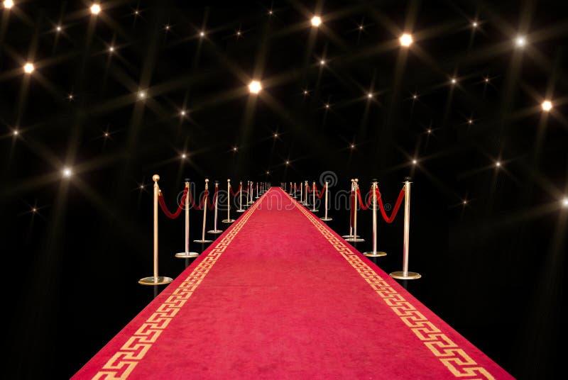 Rood tapijt en flits stock foto