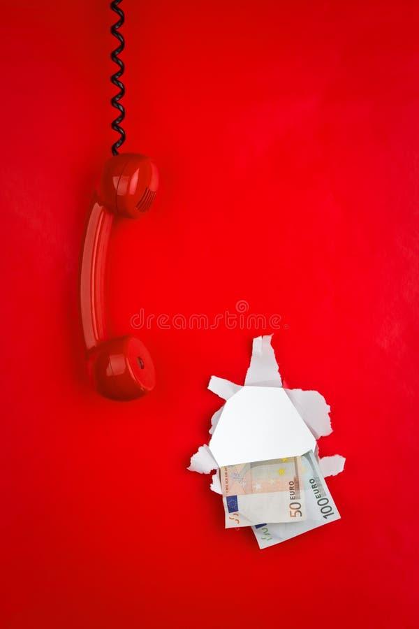 Rood telefoon en geld stock fotografie