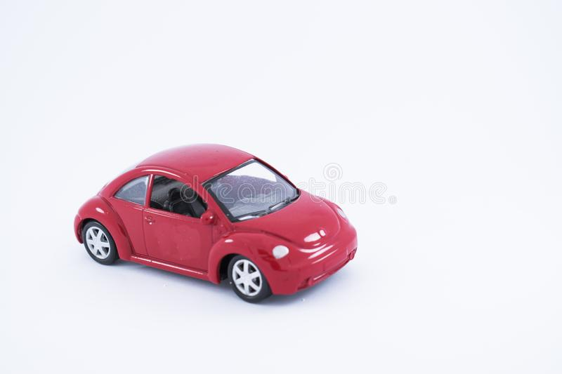 Rood Toy Car met witte achtergrond stock foto's