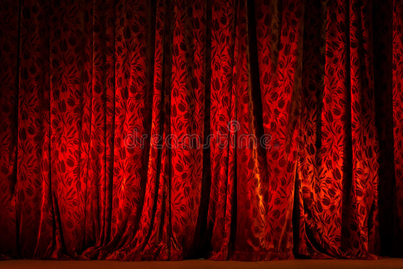 Rood verlicht Theatergordijn royalty-vrije stock foto's