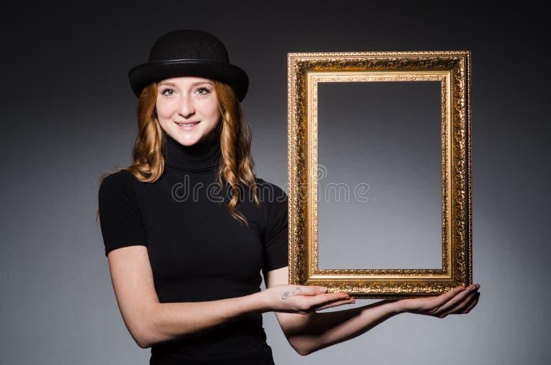 Roodharige met omlijsting stock fotografie