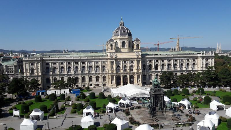 Rooftop view of palace courtyard. Roodtop view of the Naturhistorisches Museum Wien and the towers of the Votivkirche stock photography