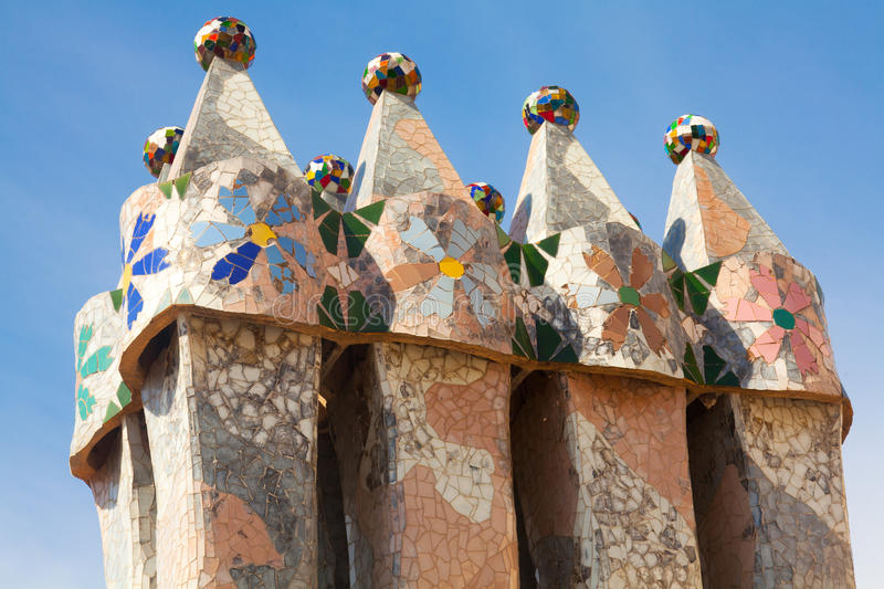 Roof architecture at Casa Batllo. Building restored by Antoni Gaudi and Josep Maria Jujol. Complex chimney detailing of the roof is arched and was likened to royalty free stock images