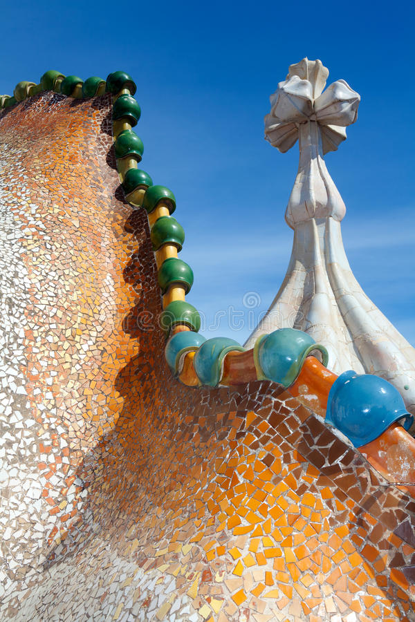 Roof architecture at Casa Batllo. Building restored by Antoni Gaudi and Josep Maria Jujol. Complex chimney detailing of the roof is arched and was likened to stock image