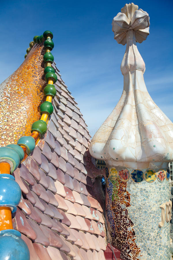 Roof architecture at Casa Batllo. Building restored by Antoni Gaudi and Josep Maria Jujol. Complex chimney detailing of the roof is arched and was likened to royalty free stock image