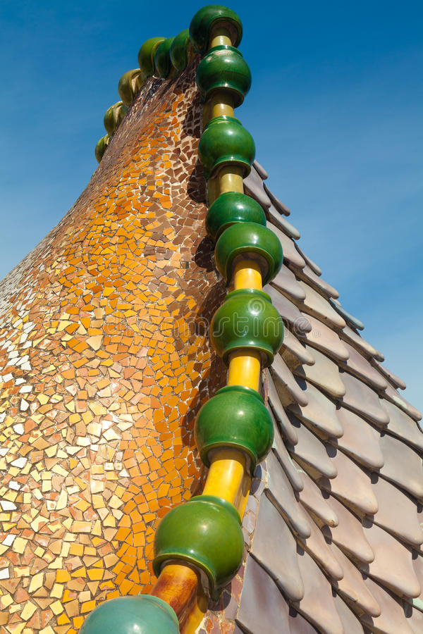 Roof architecture at Casa Batllo. Building restored by Antoni Gaudi and Josep Maria Jujol. Complex chimney detailing of the roof is arched and was likened to royalty free stock photos