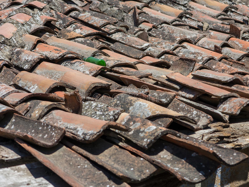 Roof at Bad Condition. Horizontal photo of a roof at bad condition. Tiles are totally broken. The rooftop is dirty royalty free stock images