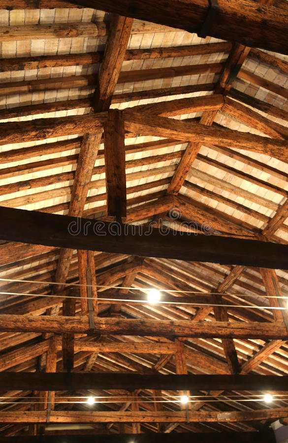 Roof with beams facing bricks and halogen lamps royalty free stock photos