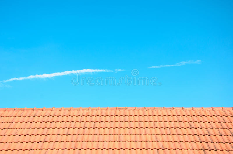 Roof and blue sky background. Red roof and blue sky for background stock photos
