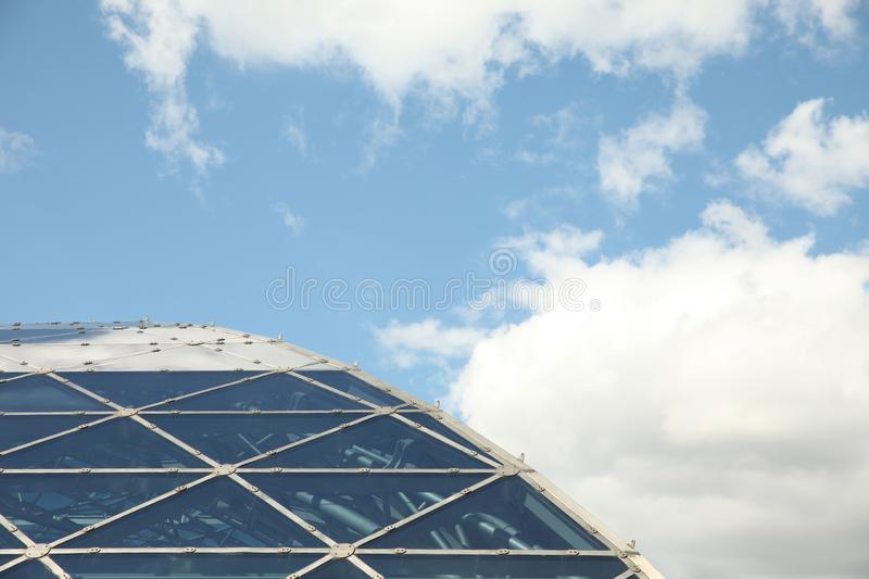Roof of the building with a geometric pattern against a blue sky with clouds. Moscow. 14.08.2015 royalty free stock images