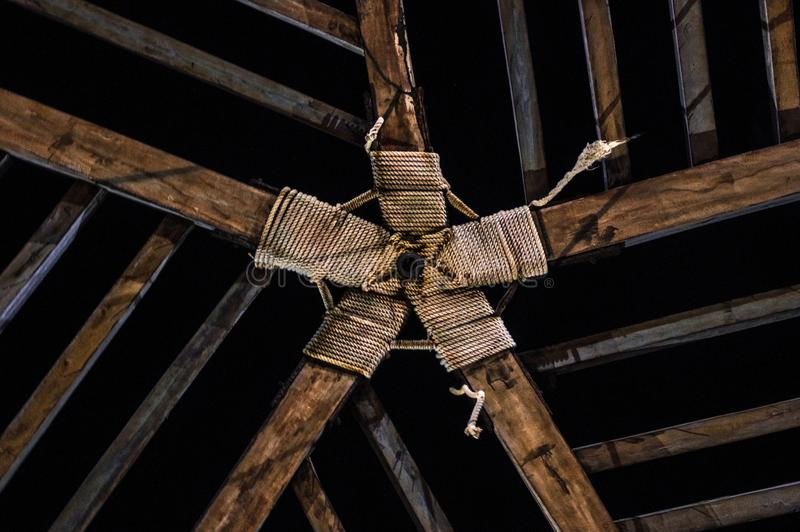 Roof of a cabin with symmetrical wooden design. Wooden cabin with a symmetrical design on the roof that allows you to appreciate the stars on a clear night royalty free stock photo