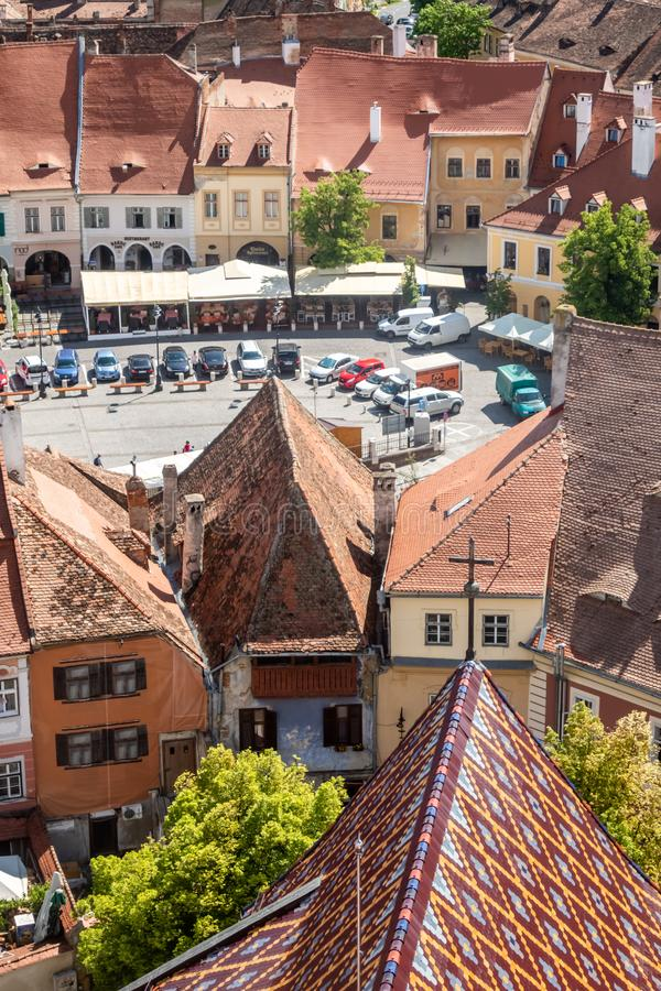 Roof of the Cathedral of Saint Mary and view of The Small Square Piata Mica, Sibiu, Romania stock image