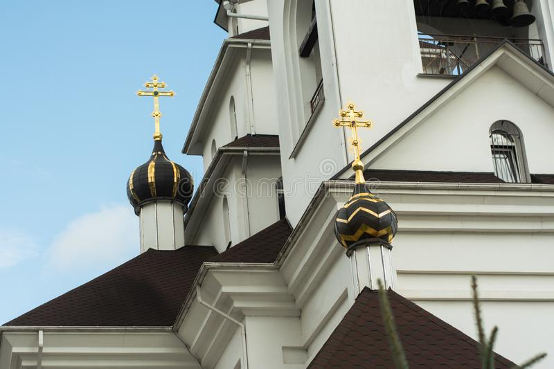 Roof with church bathing with gold orthodox crosses installed on it stock photography