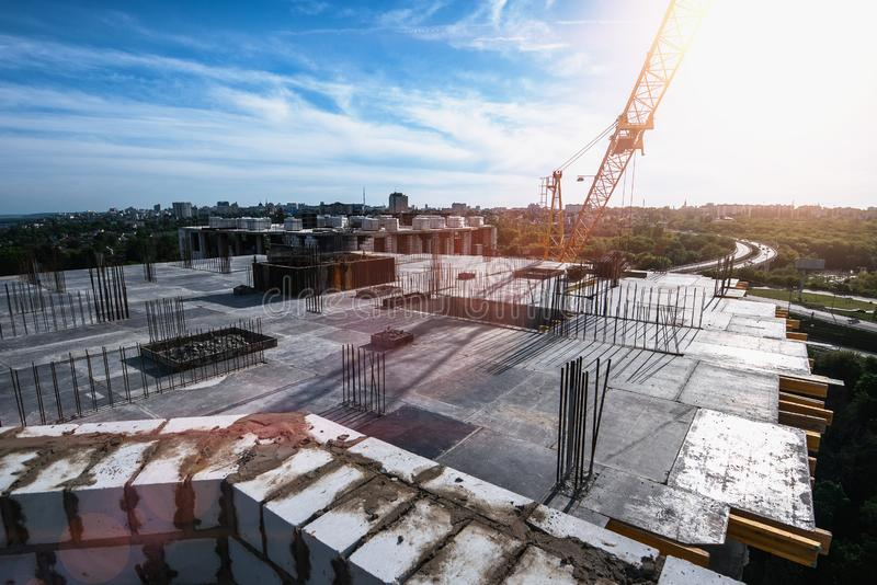 Roof of construction site of new multi-storey residential building, industrial construction crane and other industry. Equipment stock photo