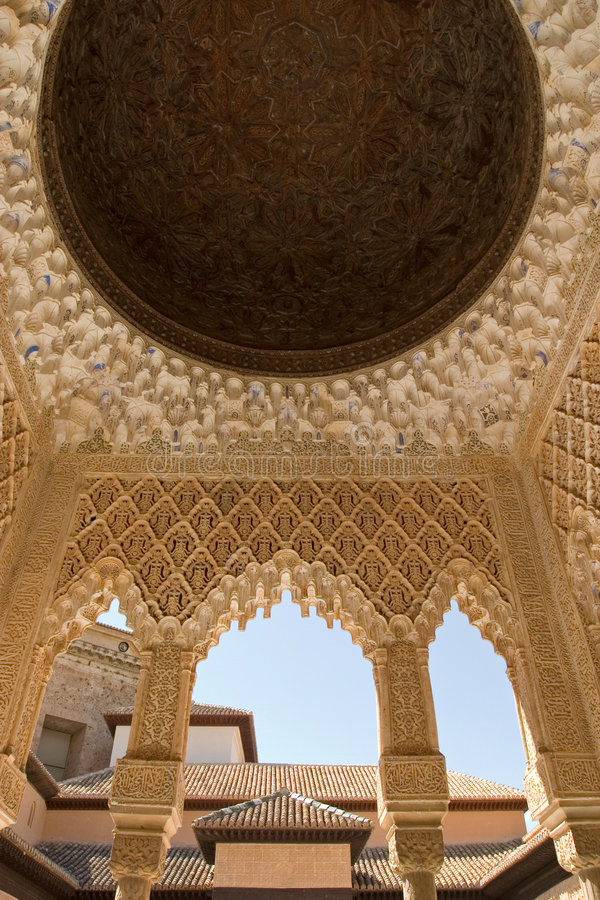 Roof detail in Alhambra. The celebrated Patio de los Leones (Court of the Lions) is an oblong court, 116 ft (35 m) in length by 66 ft (20 m) in width, surrounded stock photography
