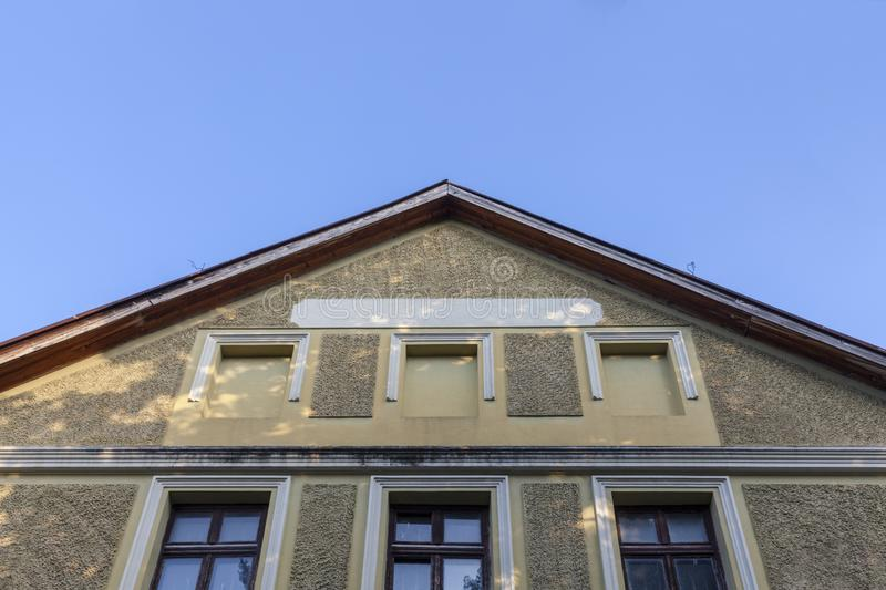 Roof and facade of the old building royalty free stock images