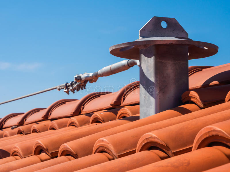 Roof fall protection system. Roof anchor - Fall arrest system for secure access to the roof royalty free stock photo