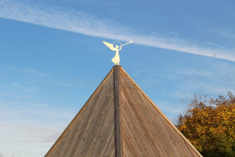 A roof with a figure of an angel with a trumpet stock photos
