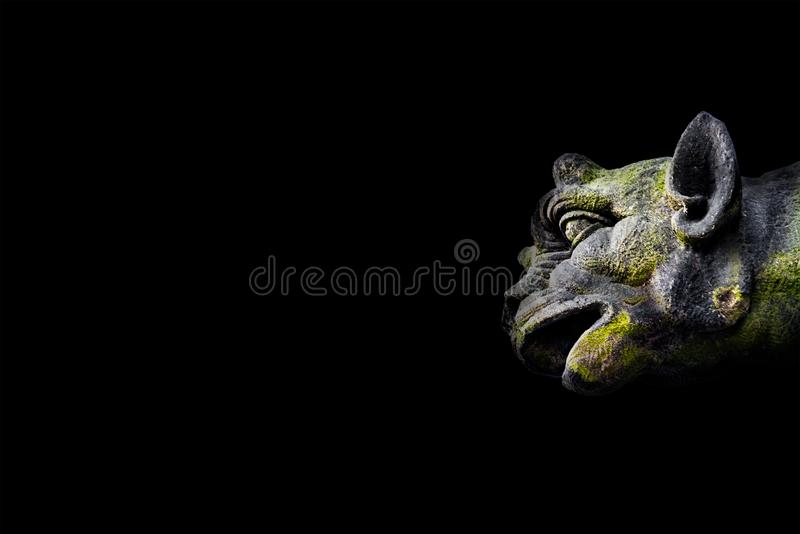 Roof figure of scary gargoyle at main facade of cathedral in Mag royalty free stock image