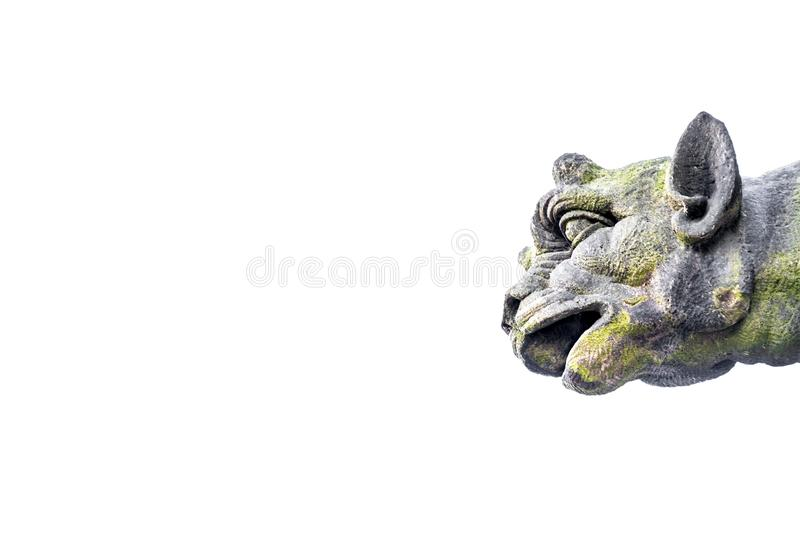 Roof figure of scary gargoyle at main facade of cathedral in Mag stock photo