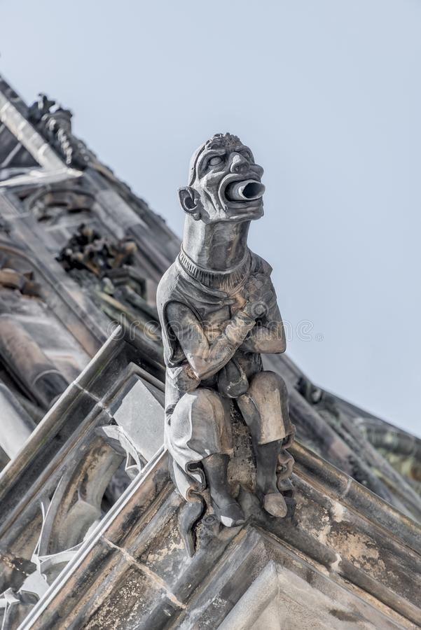 Roof figure of scary gargoyle at main facade of Saint Vitus Cathedral in Prague, Czech Republic, details, closeup royalty free stock photo