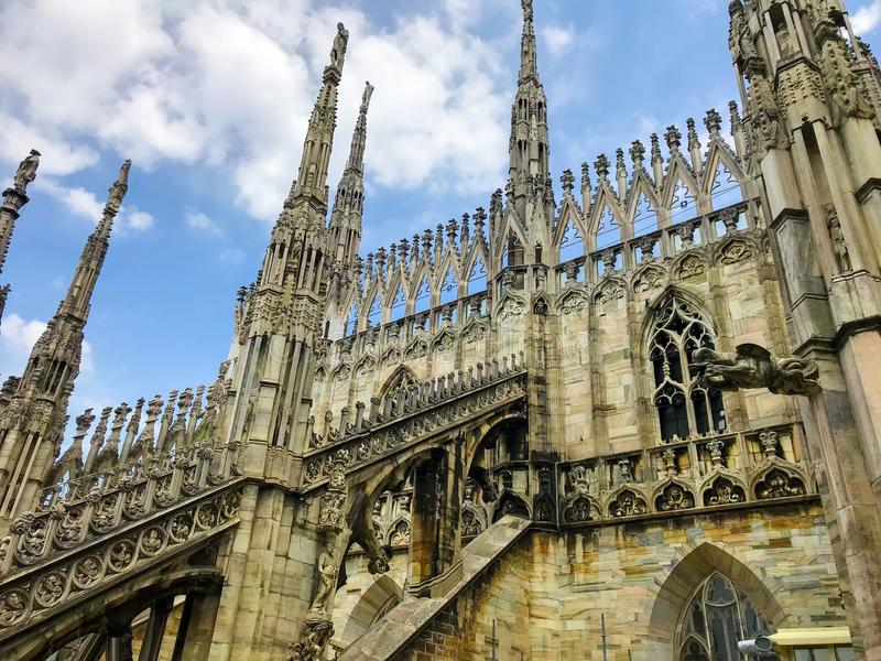 Fantasy city - Rooftops of Duomo Cathedral, Milan, Italy. The roof of the Gothic marvel of white marble Duomo Cathedral of Milan, Italy is like a small city of royalty free stock photography