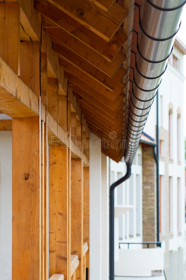 Roof gutter. Under wooden roof royalty free stock photos