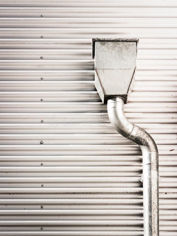 Roof gutter. Modern steel wall and roof gutter - nice background royalty free stock photography