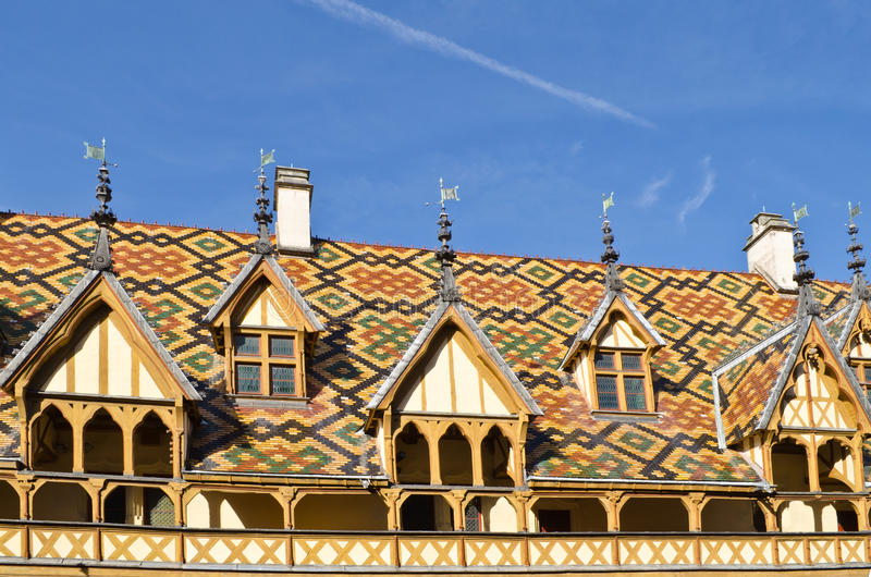 The roof of the Hospice, Beaune. Famous hospice (Hotel Dieu) in Beaune, France royalty free stock image