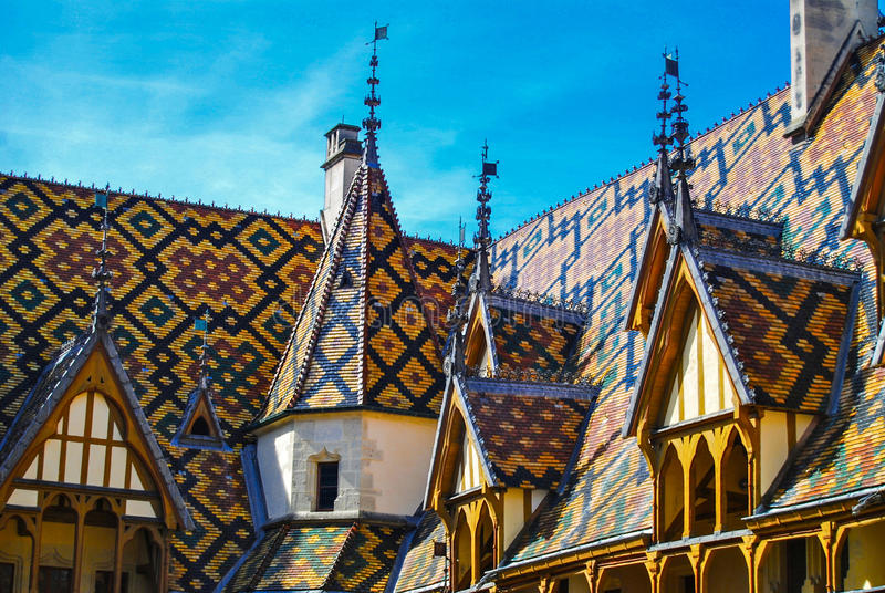 Hospices de Beaune Hotel Dieu Roofline. A hospital from the Middle Ages. The Hospices de Beaune is one of Frances most prestigious historic monuments. Its stock photo