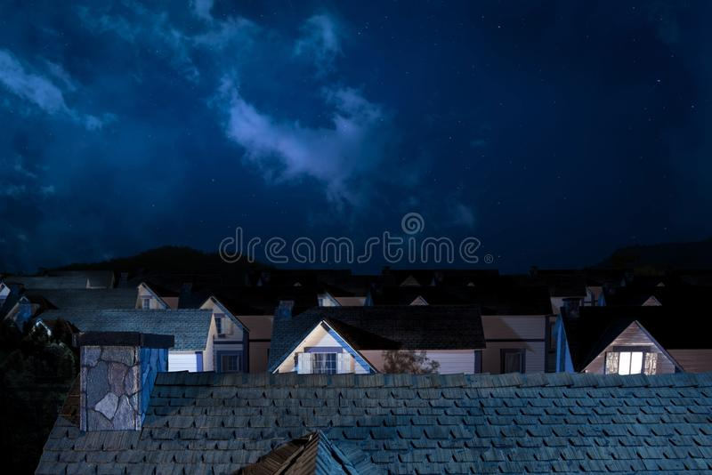 Roof Of House At Night With Houses On Background Royalty
