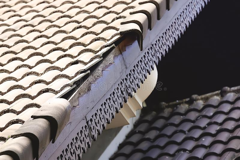 Home roof damage after storm surge. stock image