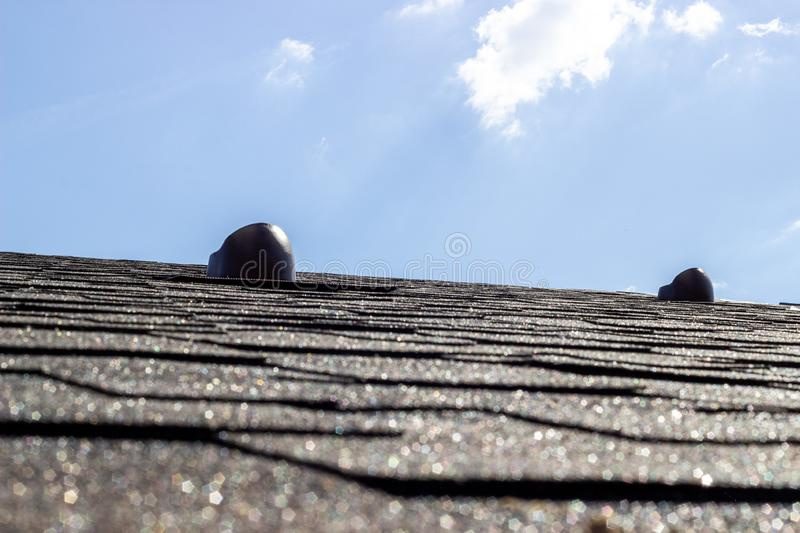 The roof of the house. Tile. Construction of houses. Chimneys. stock photography