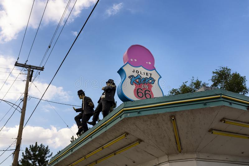 The roof of the ice cream stand Rich & Creamy with the blues brothers figures, in the city of Joliet, aling the historic route 66. Joliet, Illinois, USA - July 5 stock photos