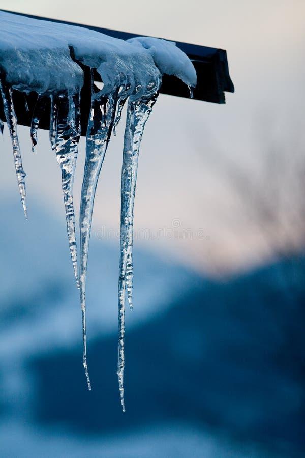 Roof icicle dusk stock photo