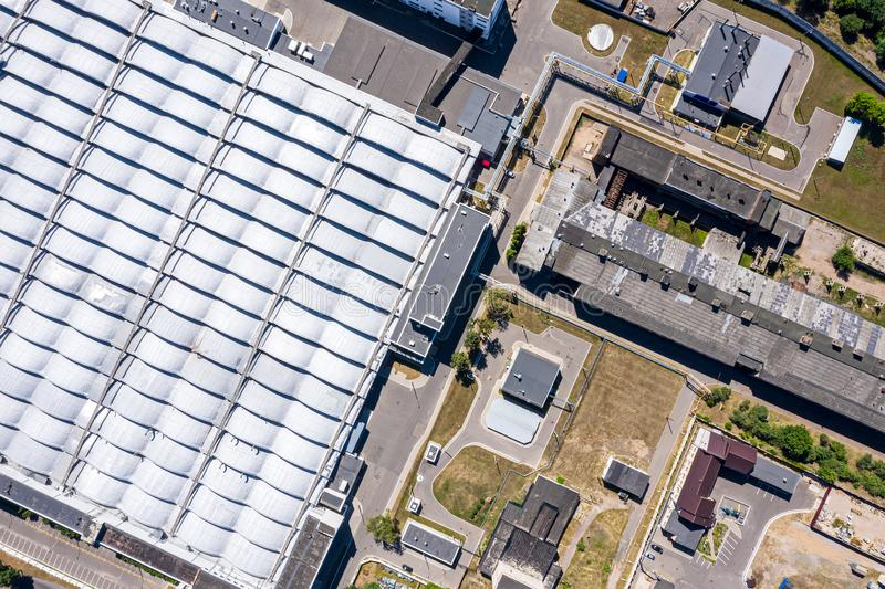 Roof of industrial distribution warehouse from above. Drone photography stock photo