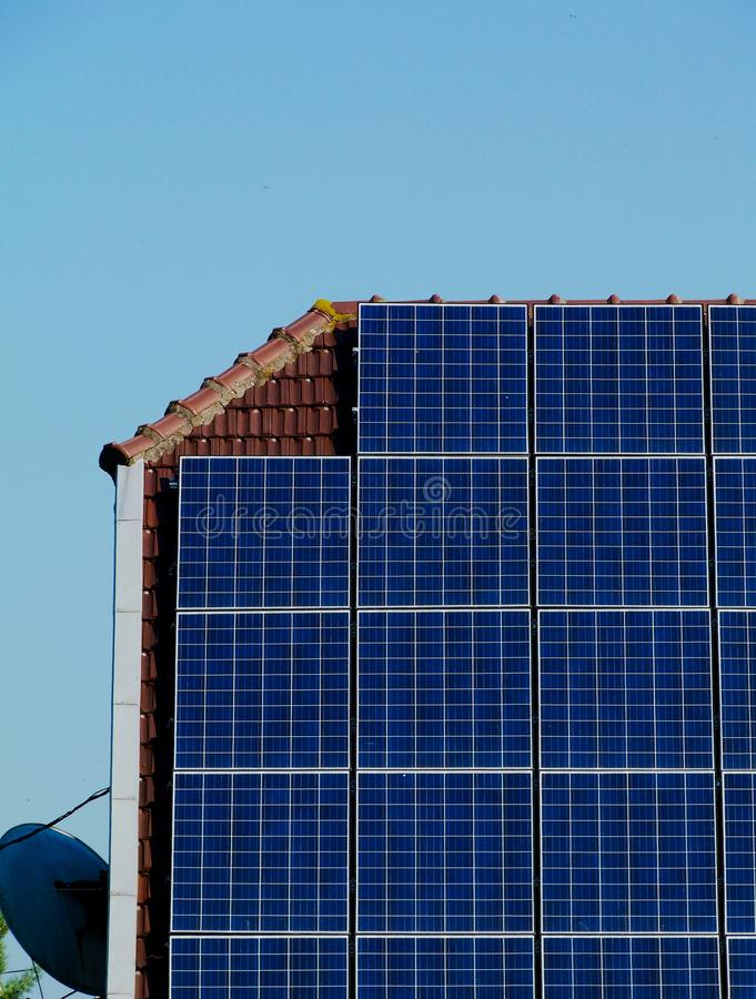 Roof installed solar panel detail under blue sky royalty free stock images