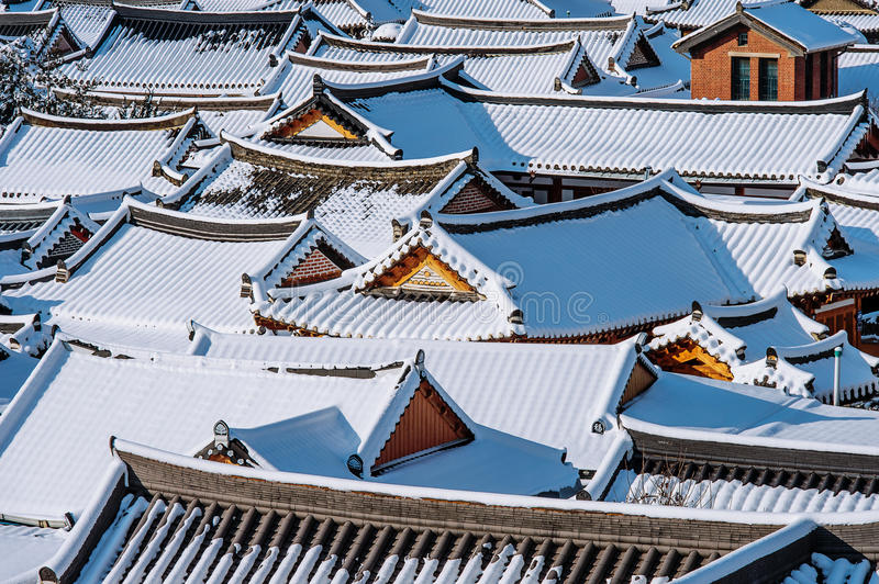 Roof of Jeonju traditional Korean village covered with snow, Jeonju Hanok village in winter, Korea. royalty free stock photos