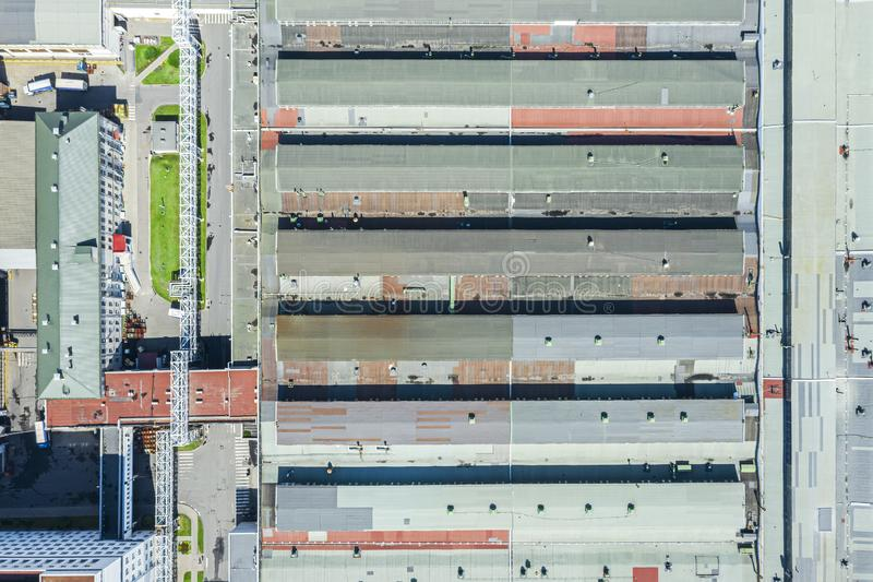 Roof of large warehouse at city industrial area, aerial view stock image