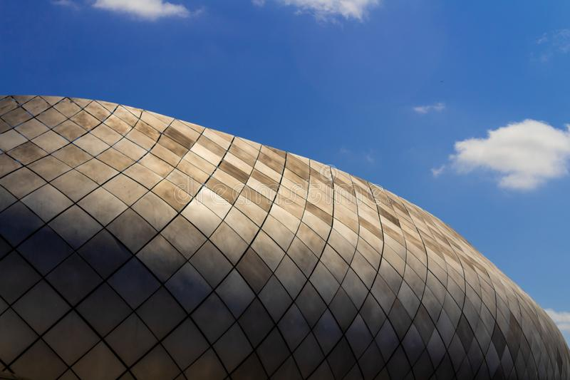 The roof of a modern building against the sky royalty free stock image