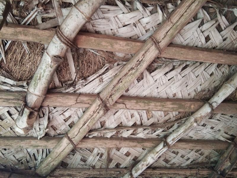 Roof of old tatched roof house.with coconut leaf sheet. royalty free stock photography