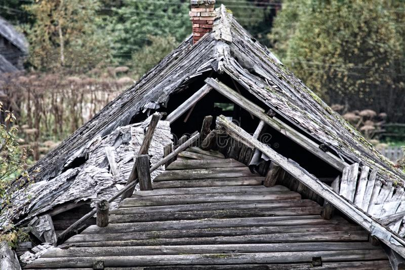 The roof of an old Veps house. The roof of an old Veps-karelian house, North-West of Russia. Pay attention to the ancient way to cover the roof with wooden tiles royalty free stock photo